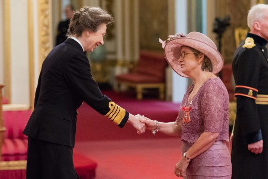 Lyn receiving her MBE